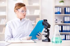 The woman chemist working in hospital clinic lab. Woman chemist working in hospital clinic lab Royalty Free Stock Image