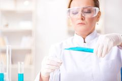 The woman chemist working in hospital clinic lab. Woman chemist working in hospital clinic lab Stock Photos