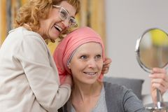 Woman after chemotherapy receiving scarf royalty free stock image