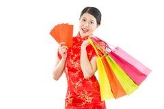 Woman in cheongsam holding shopping bag Royalty Free Stock Photo