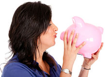 Woman cherishing her savings Stock Image