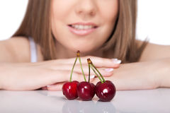 Woman and cherries. Desire woman with cherries, cherries in focus, isolated on white background Royalty Free Stock Photo