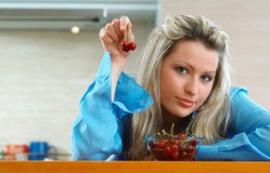 Woman with cherries Stock Photos