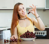 Woman with cherries in home Royalty Free Stock Photos