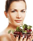 Woman with cherries over white Royalty Free Stock Photos