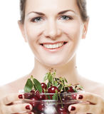 Woman with cherries over white Royalty Free Stock Photography