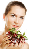 Woman with cherries over white Royalty Free Stock Image