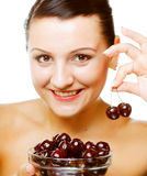 Woman with cherries over white Stock Images
