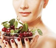 Woman with cherries over white Stock Photography