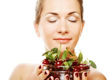Woman with cherries over white Royalty Free Stock Photo