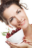 Woman with cherries over white Stock Photos