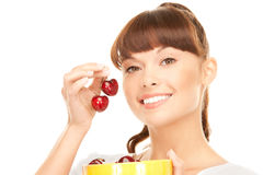 Woman with cherries Royalty Free Stock Images