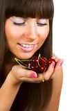 woman with  cherries on white Stock Images