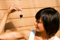 Woman with Cherry Stock Images