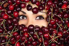 Woman in cherry Stock Photo