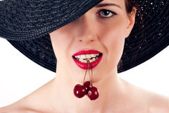 Woman with cherry in mouth Royalty Free Stock Photo