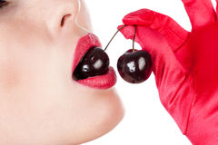 Woman with cherry in mouth Royalty Free Stock Images