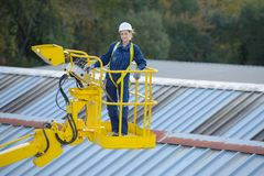 Woman in cherry picker bucket. Cherry stock photography