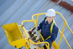 Woman in cherry picker bucket. Cherry stock photos