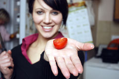 Woman with cherry tomato Royalty Free Stock Photography