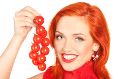 Woman with cherry tomatoes. Picture of lovely woman showing a cherry tomatoes Stock Photography