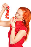 Woman with cherry tomatoes. Portrait of young woman tasting a cherry tomatoes Stock Photos