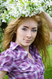 Woman in cherry tree blossom Royalty Free Stock Photos