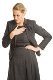 Woman with chest pain Royalty Free Stock Images