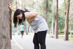 Woman chest pain while jogging stock images