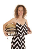 Woman chevron dress football and helmet smiling Royalty Free Stock Photos