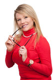 Woman chewing her glasses royalty free stock image