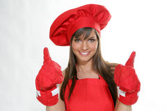 Woman chief_8. A young and pretty chef in red with gloves Royalty Free Stock Image