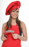 Woman chief chopper. A young and pretty chef in red with a chopper Royalty Free Stock Photography