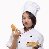 Woman chief served plate of croissant Stock Images