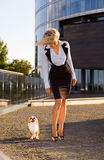 Woman with chihuahua in downtown. Royalty Free Stock Photo