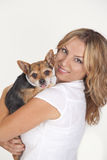 Woman with chihuahua. Portrait of happy young woman holding chihuahua dog, studio background Royalty Free Stock Image