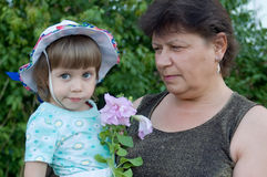 The woman with the child. And a flower stock photos