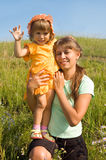 The woman with the child. On a meadow stock photos