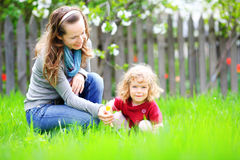 Woman and child. In summer garden royalty free stock photos