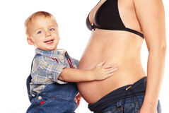 Woman with child. Pregnat Woman with child, they are happy royalty free stock photography