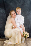 The woman and the child. The bride near to  the younger brother or the nephew Royalty Free Stock Images