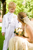 The woman and the child. The bride near to  the younger brother or the nephew Stock Photo