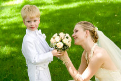The woman and the child. The bride near to  the younger brother or the nephew Stock Photos