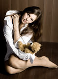 Woman-child. Beautiful young woman with bear toy Royalty Free Stock Photo