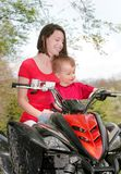 Woman and child on ATV Stock Photos