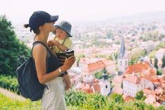 Woman and child on background of Ljubljana City, Slovenia. Trave Stock Photo