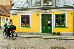Woman with child on a bike in the old town of Lund, Sweden Stock Images