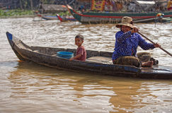 Woman and child in boat, Tonle Sap, Cambodia Stock Photography