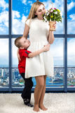 Woman and child with bouquet of flowers. Spring family holiday concept. Women`s day. Spring family holiday concept. Women`s day stock images