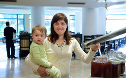 Woman with child in buffet Royalty Free Stock Photos